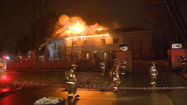 At one point, firefighters were pumping more than 10,000 litres of water every minute through the roof of the home.